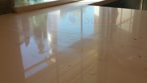 Engineered Stone Countertop with scratch marks from previous repair attempt